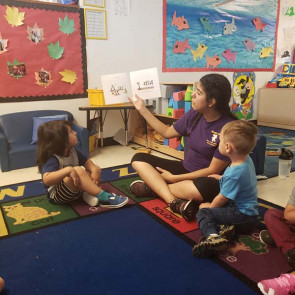 instructor reading to children